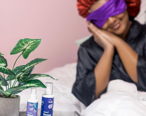Black woman in bed with silk eye mask